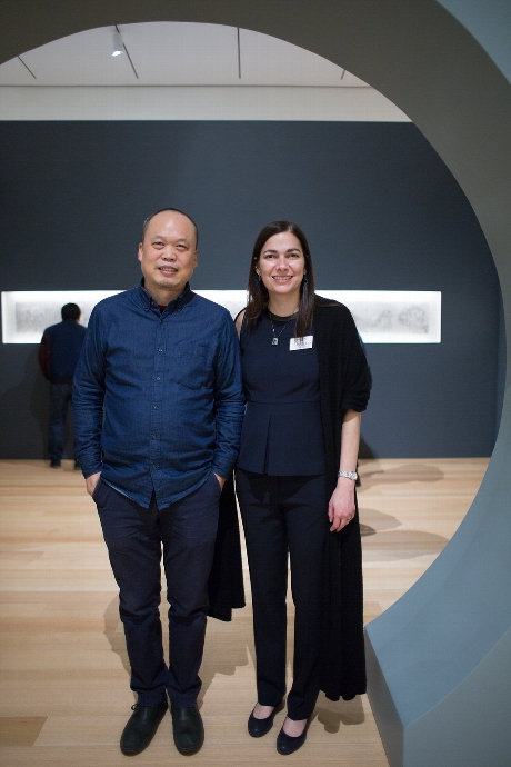 Artist Yun-Fei Ji and Wellin Museum Director Tracy L. Adler standing under the moongate in Ji's exhibition
