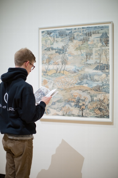 Hamilton student Sawyer Konys '16 reads the Chinese to English translation while viewing work by Yun-Fei Ji © Janelle Rodriguez