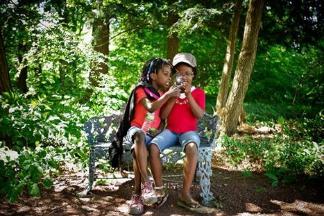 Hannah, 7, and Naimo Gardner-Woods, 8, look at photos in Root Glen. They're the daughters of Ruth Gardner-Woods '99.