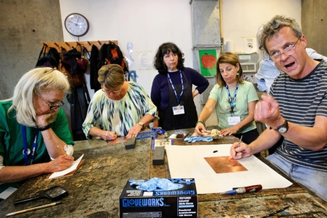 Jake Muirhead '86, right, gives tips during a printmaking workshop.