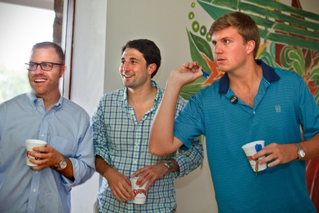 Garrett Wilson '07, right, plays darts with fellow frat brothers at the Theta Delta Chi house party during reunion weekend.