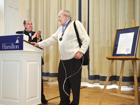 Aron Ain '79 claps for Chairman's Award recipient Perry L. Wheaton '63 during the annual Alumni Association Meeting.