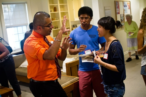 Director of Diversity and Inclusion Amit Taneja speaks with Ujjwal Pradhan '15 and Trang Nguyen '14 during the Days-Massolo Center Open House.