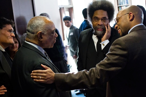 Professor of Africana Studies Donald Carter, left, and Professor of Philosophy Todd Franklin chat with Cornel West.