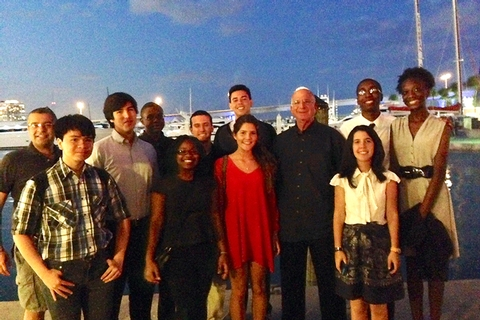 Art Massolo '64 poses with Miami Posse students.