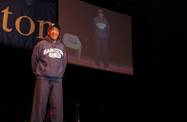 Cosby graced the stage wearing a Hamilton sweatshirt and cap.