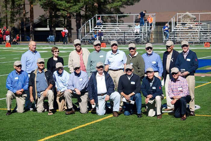Members of the Class of 1963 football team during halftime with President Stewart and Jon Hind '80.  PHOTO: BY SAM FINKELSTEIN '14