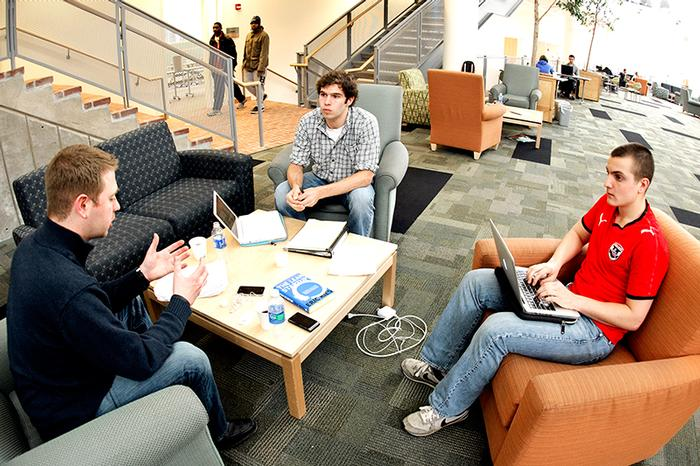 Mark Kasdorf '06, left, works with students Ben Yudysky '14 and Teddy Clements '14.