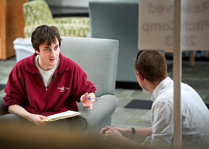Mark Kasdorf '06, right, talks with a student during a mentoring session. PHOTO: NANCY L. FORD