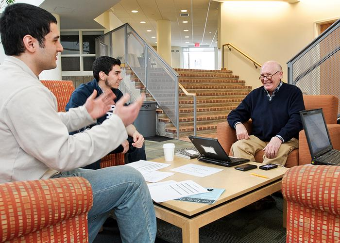 Farzad Khosravi '16 and Michael Nelson '15 meet with mentors Michael Fawcett '66 and Hedy Foreman on April 5. The students were part of the second-place winning team. PHOTO: NANCY L. FORD
