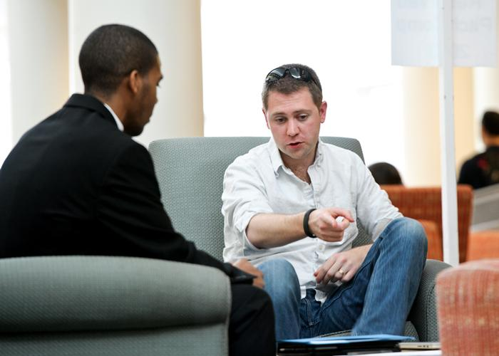 Leonard Collins '15, left, is coached by Mark Kasdorf '06, during a mentoring session. PHOTO: NANCY L. FORD