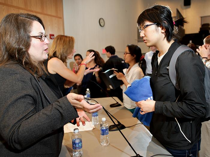 Alysia Mihalakos '01 talks to students after the panel discussion.