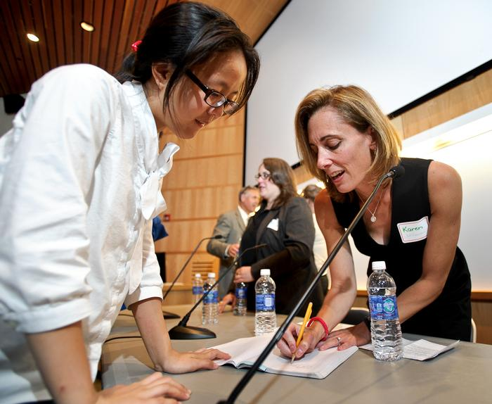 Wenlu Weng '16 talks to Karen McDonnell '91 after the panel.  PHOTO: BY NANCY L. FORD