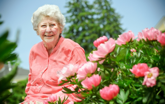 Patsy Couper W'44 poses among the peonies.<br />Photo: Nancy L. Ford