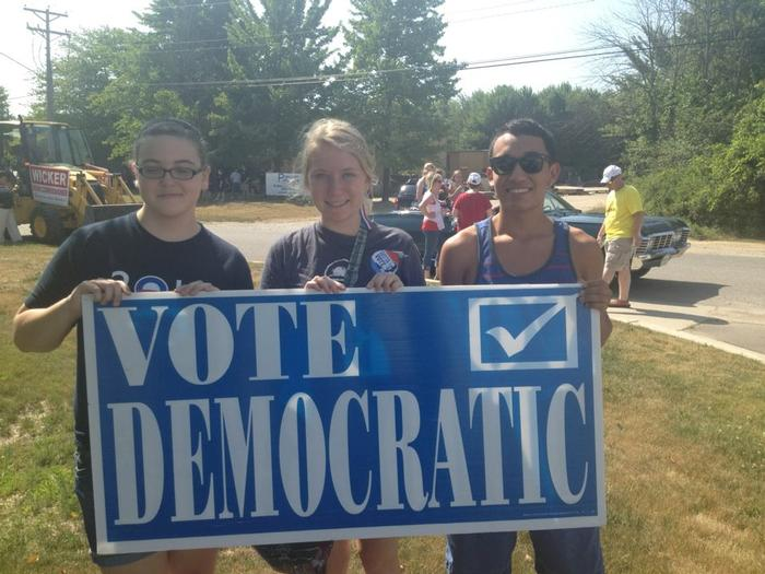 Edie Wilson '14, center, marching for Organizing for America.