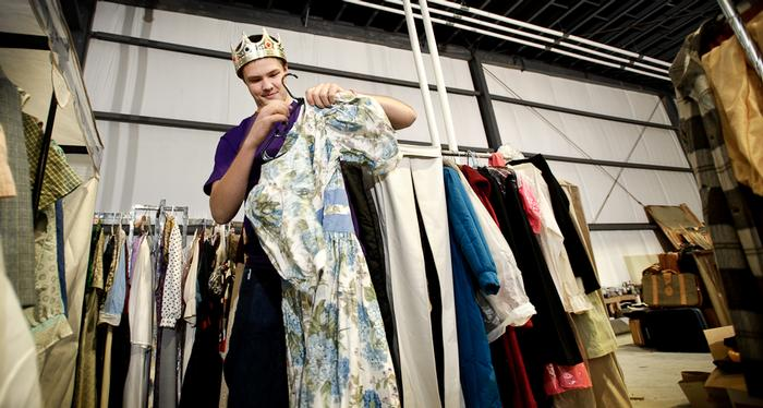 Gipper Gailor '15 sports a crown he found among props, hangs wardrobe at Player's Theater.  PHOTO: BY NANCY FORD