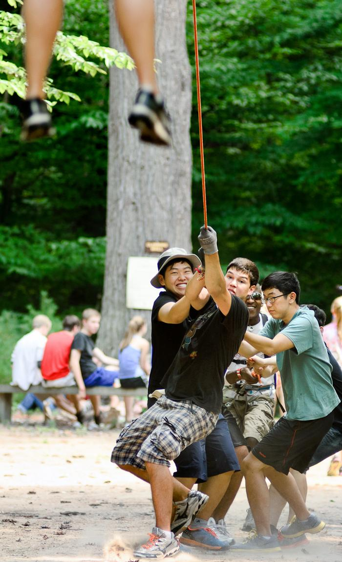 A group of students pull up a friend in the Flying Squirrel game. PHOTO: BY MEGAN BARTON