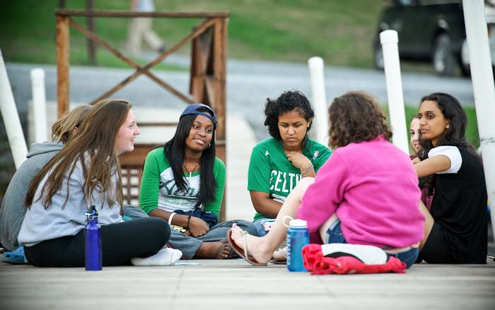 Groups meet to discuss the day's activities at the end of the day at Raquette Lake. PHOTO: BY NANCY FORD