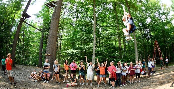 Students cheer for their classmates ziplining during AA. PHOTO: BY NANCY FORD