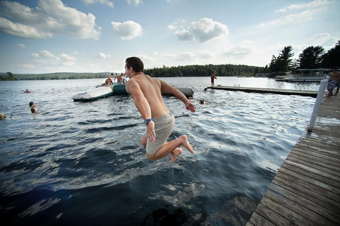 Students unwind with a swim at the Raquette Lake camps during Adirondack Adventure. PHOTO: BY NANCY FORD
