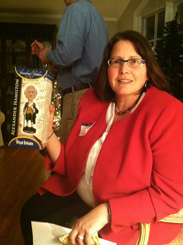 Melissa Joyce-Rosen receives a bobble head at the Rochester party.