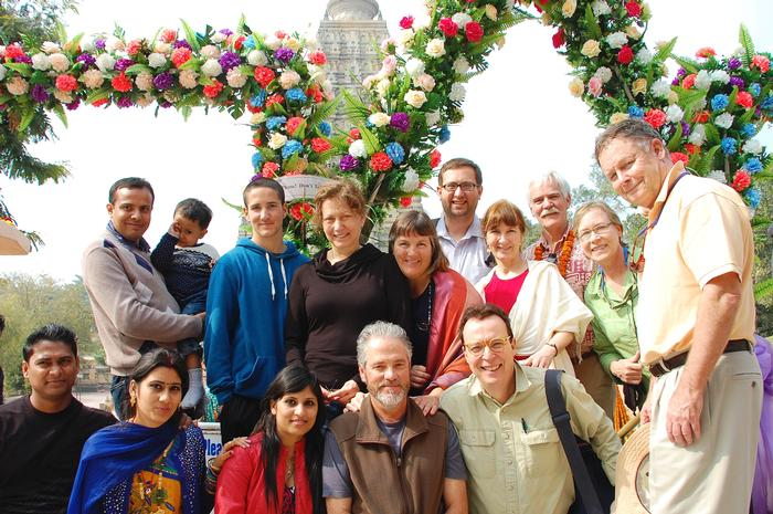 Amar's family members and the Mystic India group at the entrance to the most important Buddhist shrine in Bodhgaya, India, (and in the world), behind which is located the site of Buddha's enlightenment.