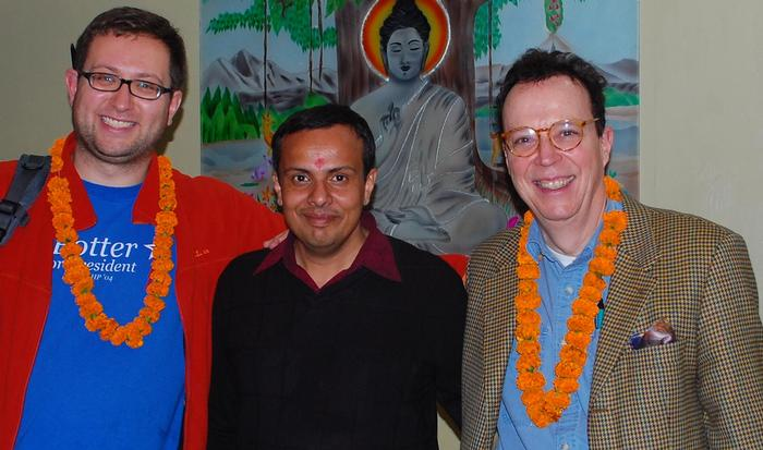 From left, ITS Educational Technologist Ted Fondak, Assistant Professor of Religious Studies Abhishek Amar and Professor of French John O'Neal in front of a painting of the Buddha in India.
