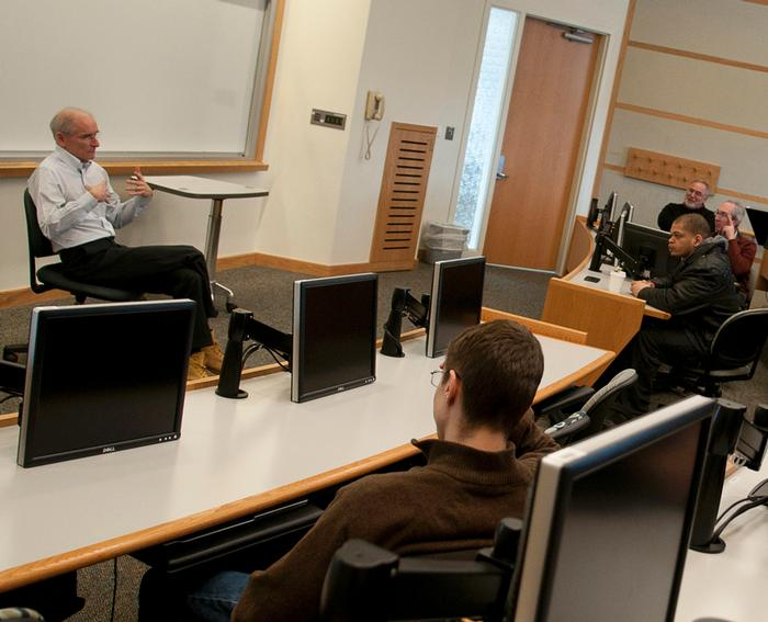 Henry Bedford '76 discussed international finance with Balkan's class on march 2 PHOTO: BY CLAUDETTE FERRONE