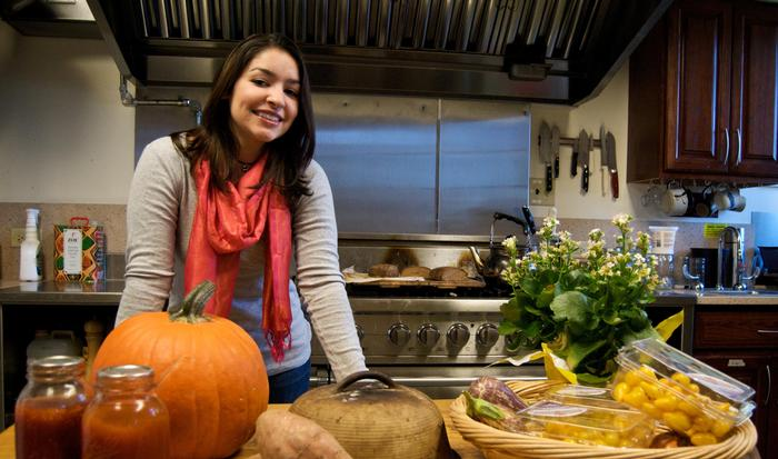 Caitlin Taborda '11 in the Woollcott kitchen.