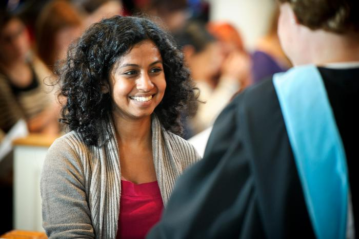 Ramya Ramnath '13 receives an award. PHOTO: BY NANCY L. FORD
