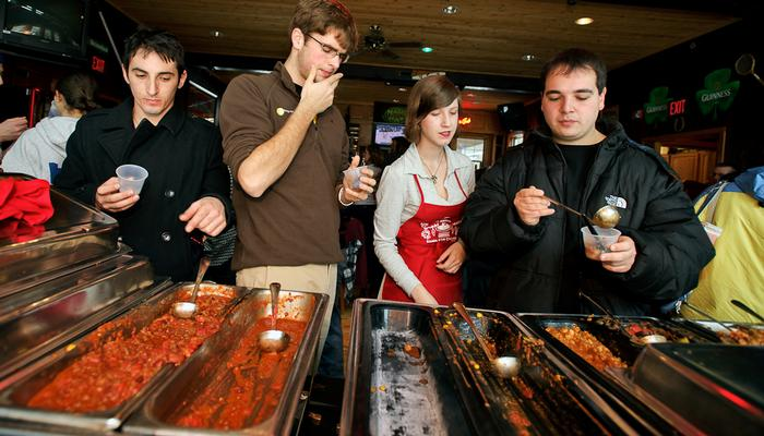 Steve Lucchetti '12, Ben Swett '14, contestant Kelsey Brow '12 and Richard Karrat '12 review the entries. PHOTO: BY NANCY FORD