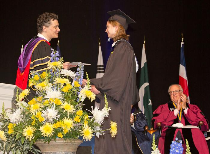 Valedictorian Sarah Hammond accepts congratulations from Dean of Faculty Patrick Reynolds. PHOTO: VICKERS & BEECHLER