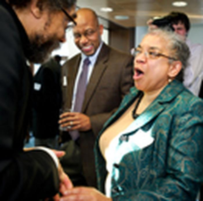 Professor of Classics Shelley Haley and Cornel West share a laugh during a reception in Sadove Center.  PHOTO: BY NANCY L. FORD