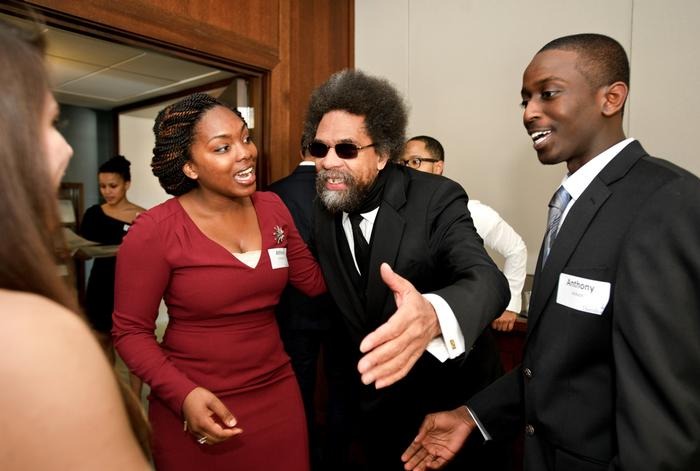 Athina Chartelain '13, right, and Anthony Jackson '15, left greet Cornel West upon his arrival. PHOTO: BY NANCY L. FORD