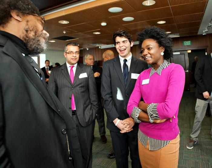Amit Taneja, Jose Vazquez '15 and Jorette Joseph '15 chat with Cornel West during a reception.  PHOTO: BY NANCY L. FORD