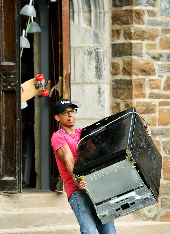 Gabriel Rivas '16 totes his new mini fridge. PHOTO: BY NANCY FORD