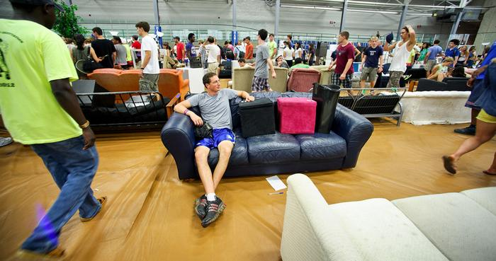 Lane Lerner '14 lays claim to a couch while waiting for moving assistance.  PHOTO: BY NANCY FORD