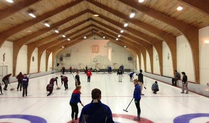 The team competing at Broomstones Curling Club in Wayland, Mass. Trevor Howe '14 is getting ready to throw the stone