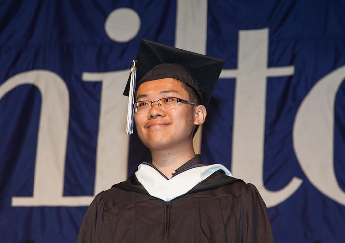 Class of 2012 valedictorian Yinghan Ding. PHOTO: BY VICKERS & BEECHLER PHOTOGRAPHY