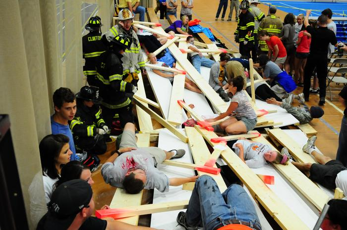 The staged bleacher collapse in the emergency drill. PHOTO: MARIANITA PEASLEE