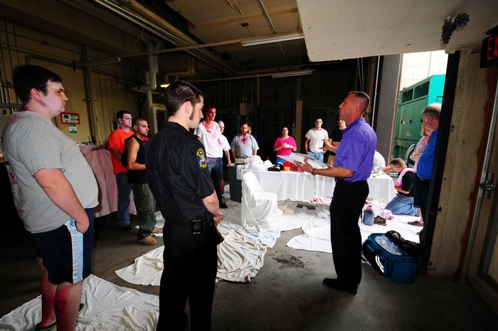 Fran Manfredo describes the mock disaster to volunteer victims. PHOTO: MARIANITA PEASLEE