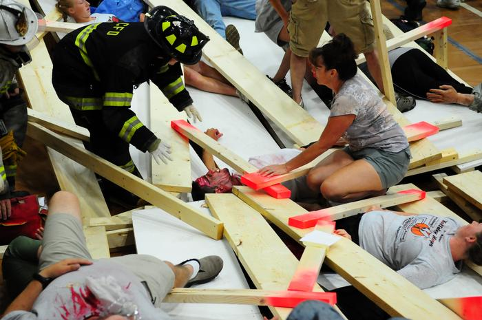 Volunteer victims are aided during the drill. PHOTO: MARIANITA PEASLEE