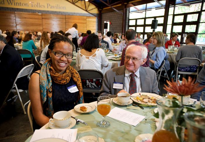 Milinda Ajawara '16 and Harry Love '52 chat during the annual Comstock Lunch.