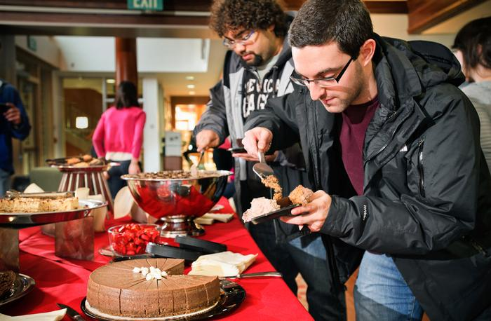 Jason Mariasis '12 helps himself to some chocolate mousse and cake. PHOTO: BY NANCY FORD