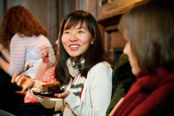 Binchan Luo '12 enjoys her chocolate treats. PHOTO: BY NANCY FORD