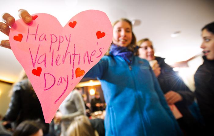 Anne Liozeaux '12 shows off a Valentine she made at the decorating event. PHOTO: BY NANCY FORD