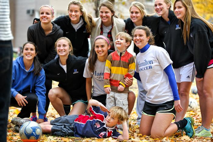 The Hamilton's Women's Soccer team poses with young fans. PHOTO: BY NANCY FORD