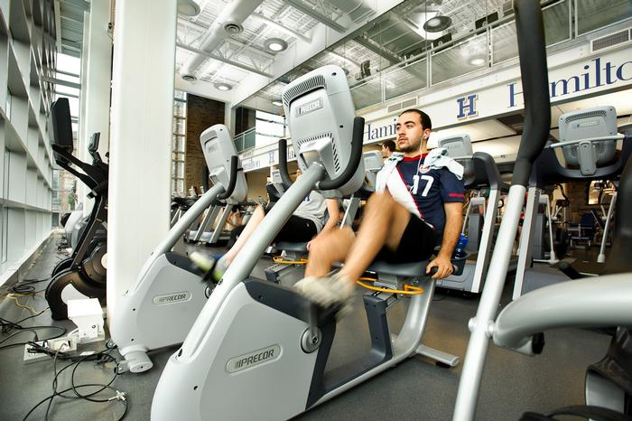 Yanki Hancioglu '14 tries out an exercise bike. PHOTO: BY NANCY FORD