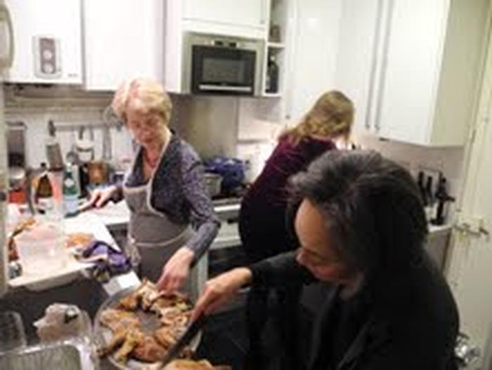 Professor Roberta Krueger puts together components of the feast in France.