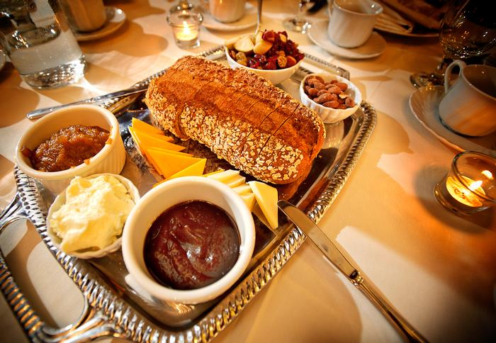 Whole grain rustic loaf bread is surrounded by whipped butter, apple butter, fruit compote, cheddar cheese and nuts.  PHOTO: BY NANCY FORD